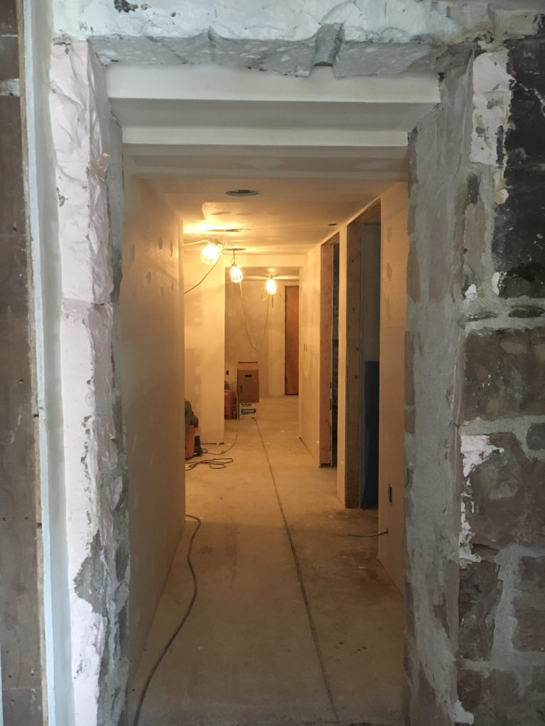 Basement hall with new drywall