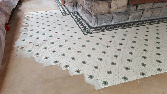 Porch tile underway