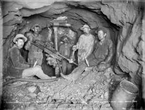 Miners with drill circa 1890