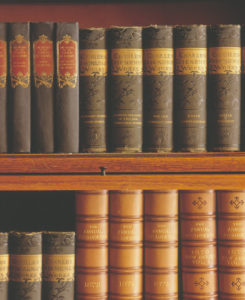 Antique Books nested together on shelves
