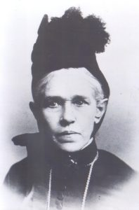 Black and white photograph of Johanna Collins Tobin from the shoulders up. She is wearing black and a small black hat.