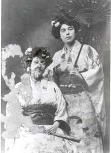Margaret and her maid Mary Mulligan dressed in kimono. Mary sits while Margaret stands holding a Japanese style umbrella. The photo is badly damaged on the half with Mary.